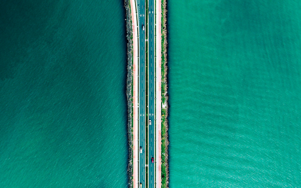 highway surrounded by blue waters