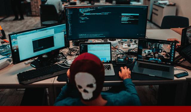 hacker behind computer